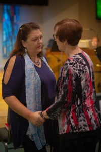 Two members in fellowship together at Abiding Grace Lutheran Church