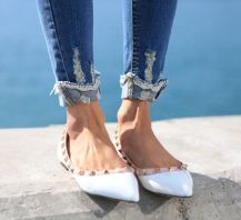 ripped jeans and rockstud flats