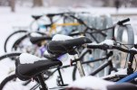 Bike seats accumulate snow during the winter storm at the Bovee University Center on March 1, 2016.