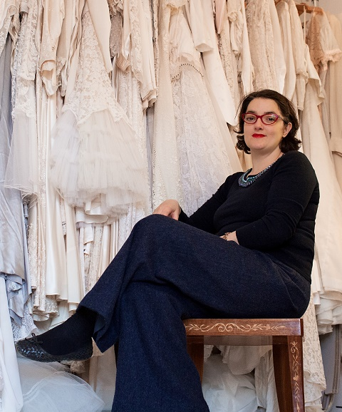 Abigail Haughton with some of her collection of vintage wedding dresses