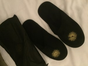 cute little slippers by the bed..great for answering in room dining delivery