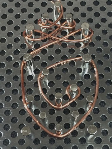 Copper wire formed on a metal jig