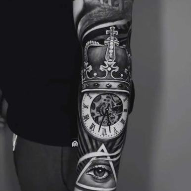 clock-crown-eye-triangle-arm-sleeve-tattoo.jpg