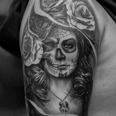 girl-skeleton-face-rose-arm-sleeve-tattoo.jpg