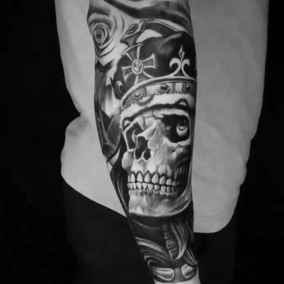 skeleton-skull-crown-arm-sleeve-tattoo.jpg