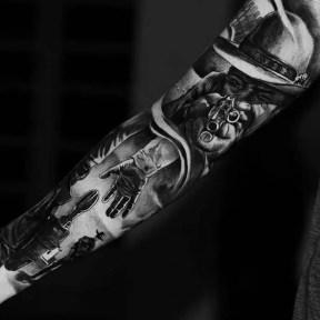 western-gun-shootout-arm-sleeve-tattoo.jpg