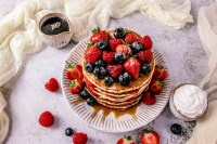 Photo of prepared pancakes with berries