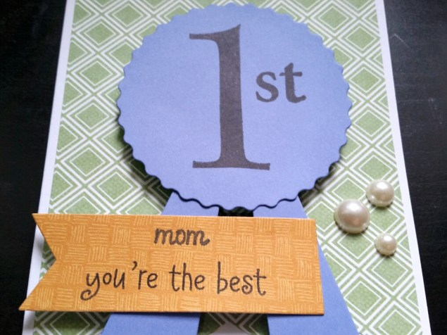 A Bit Of Glue & Paper - handmade Mother's Day card with die cut blue ribbon stamped with 1st, stamped with mom you're the best, green geometric patterned paper, embellished with pearls; Freshly Made Sketches 283 #FMS283 - Vancouver BC