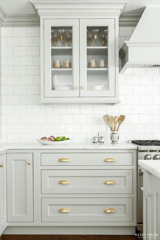 This all-white kitchen pops with gorgeous gold accents and a lovely subway tile backsplash. This is how you decorate with neutral colors!