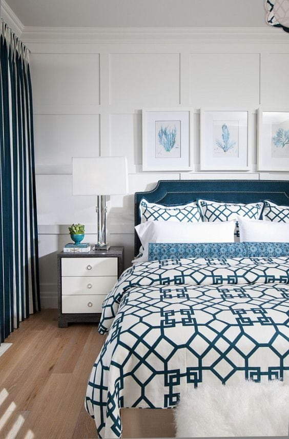 A beautiful board and batten look for behind a bed is stunning! More ideas for decorating above a bed on A Blissful Nest. https://ablissfulnest.com/