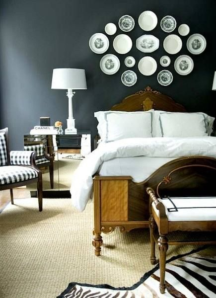 Make a gallery wall out of plates above a bed