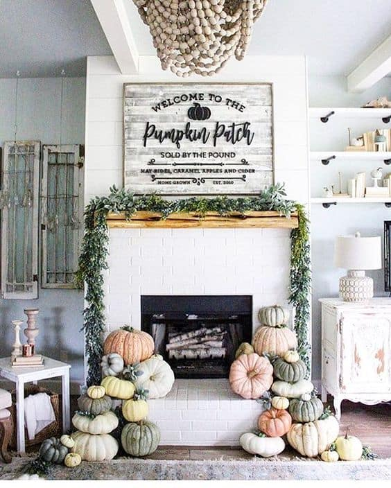 Love the cluster of pumpkins and sign on the fall mantel