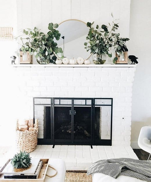 Just adding in some greenery and small white pumpkins makes a gorgeous fall mantle display.