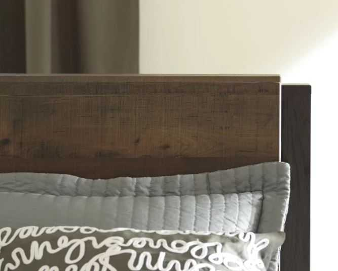 This wooden headboard presents a cool 2-dimensional style with light and dark wood. It's the perfect look for a rustic room.
