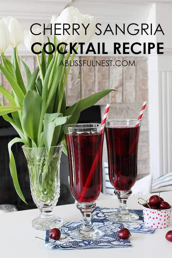 This delicious and refreshing cocktail recipe packs a punch! Full cherry sangria cocktail recipe details at ablissfulnest.com