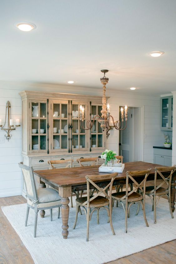 Different wood finishes in this dining room add texture without being too overwhelming, and this dining table can sit up to 8! HGTV Country House in a very Small Town, 20 Best Fixer Upper Rooms via A Blissful Nest