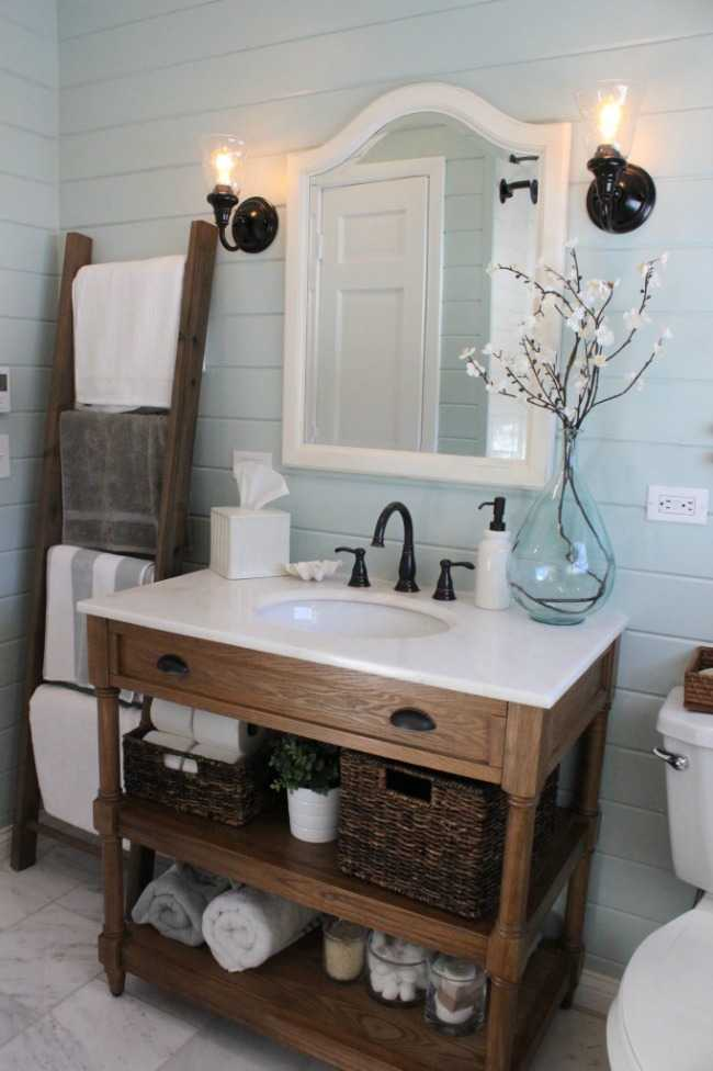 Bathroom with shiplap walls and an up-cycled piece of furniture for the vanity. Pretty soft colours. #ABlissfulNest #InteriorDesign #Decorator #Stylist #Blissful #HappyHome #designtips #Farmhouse #FarmhouseDecor #farmstyle #farmdecor