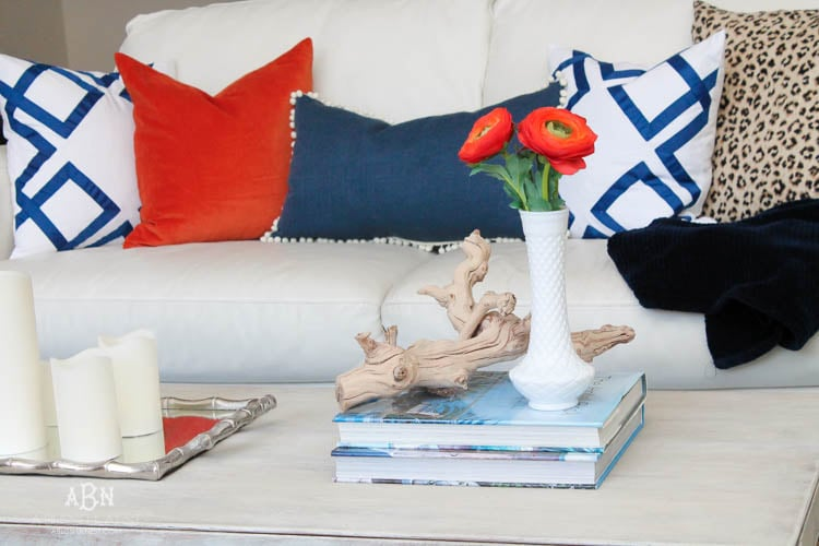 Check out these gorgeous coastal accents in this fall home tour with A Blissful Nest! Love the pops of orange in this home with its neutral pallet. See more at https://ablissfulnest.com/ #fallfrontporch #falldecorating #falldecor #fallhometour