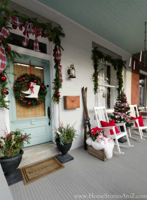 If you are looking for THE BEST ideas for Christmas front porches, then these are all so amazing!! These are all so gorgeous! See more on https://ablissfulnest.com/ #christmasporch #christmasfrontporch #christmasdecorating
