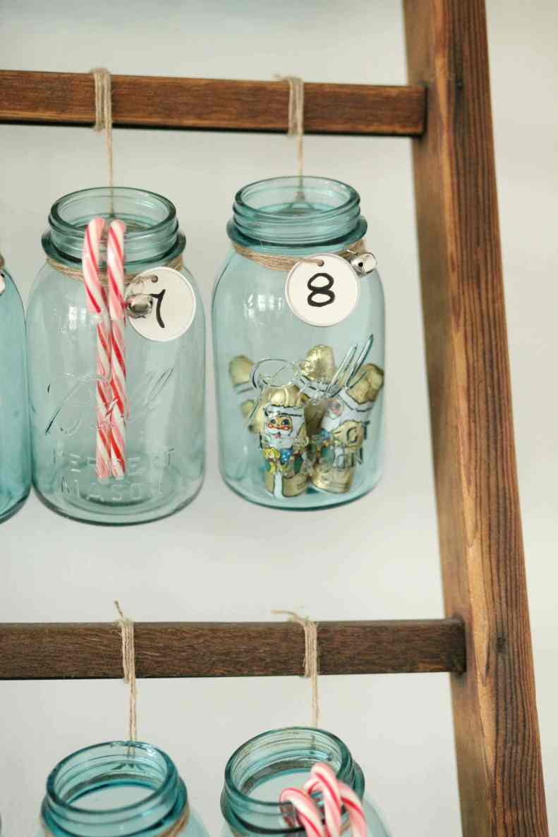 Beautiful Christmas decor using a Vintage Ladder for a Mason Jar Advent Calendar. So festive and fun! See more on https://ablissfulnest.com/ #Christmas #Advent #ChristmasDecor