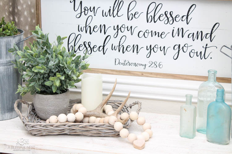 I can not believe how expensive prayer beads normally are! This DIY farmhouse wood prayer bead tutorial is so easy to make and only cost $30. What an amazing and easy DIY Farmhouse decor project! See more on https://ablissfulnest.com/ #farmhousedecor #farmhousestyle