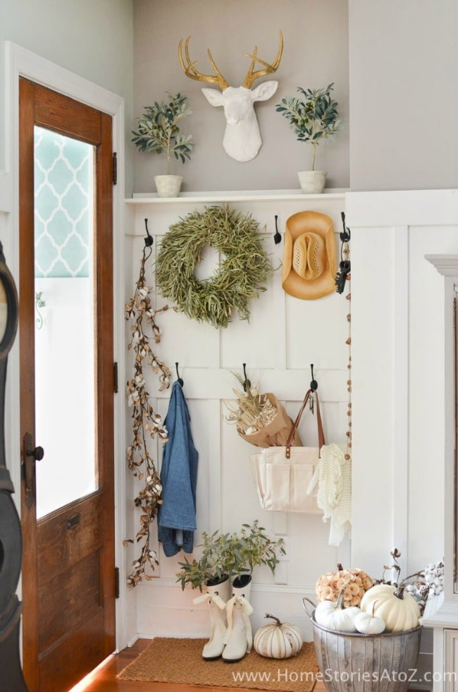 Adore this fall entryway by Home Stories from A to Z. Grab the best fall entryway ideas on https:ablissfulnest.com/ #falldecor #falldecorating #fallentrydecor