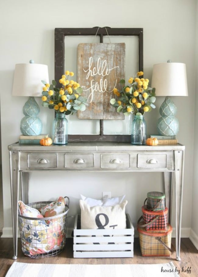 Adore this fall entryway by House by Hoff. Grab the best fall entryway ideas on https:ablissfulnest.com/ #falldecor #falldecorating #fallentrydecor