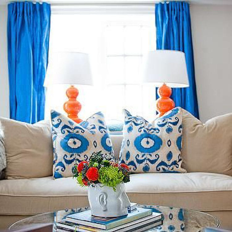 Simple tips on how to decorate with orange, from adding pops of pillows to wallpaper are on the blog, head over to https://ablissfulnest.com #interiordesign #designtips #popofcolor #paintcolors