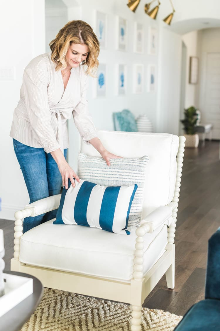 Love these navy stripe pillows to add a punch to your living room. #ad #AthomeStores #springdecorating #springdecoratingideas #coastallivingroom