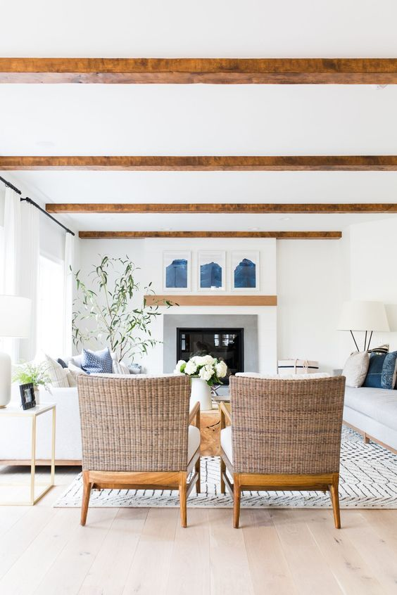 Just love the soothing color palette of this room design and those beams are incredible! #homedecor #livingroom #coastal