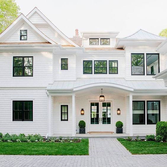 15 best white home exterior ideas to up your curb appeal - Black house with white trim ...