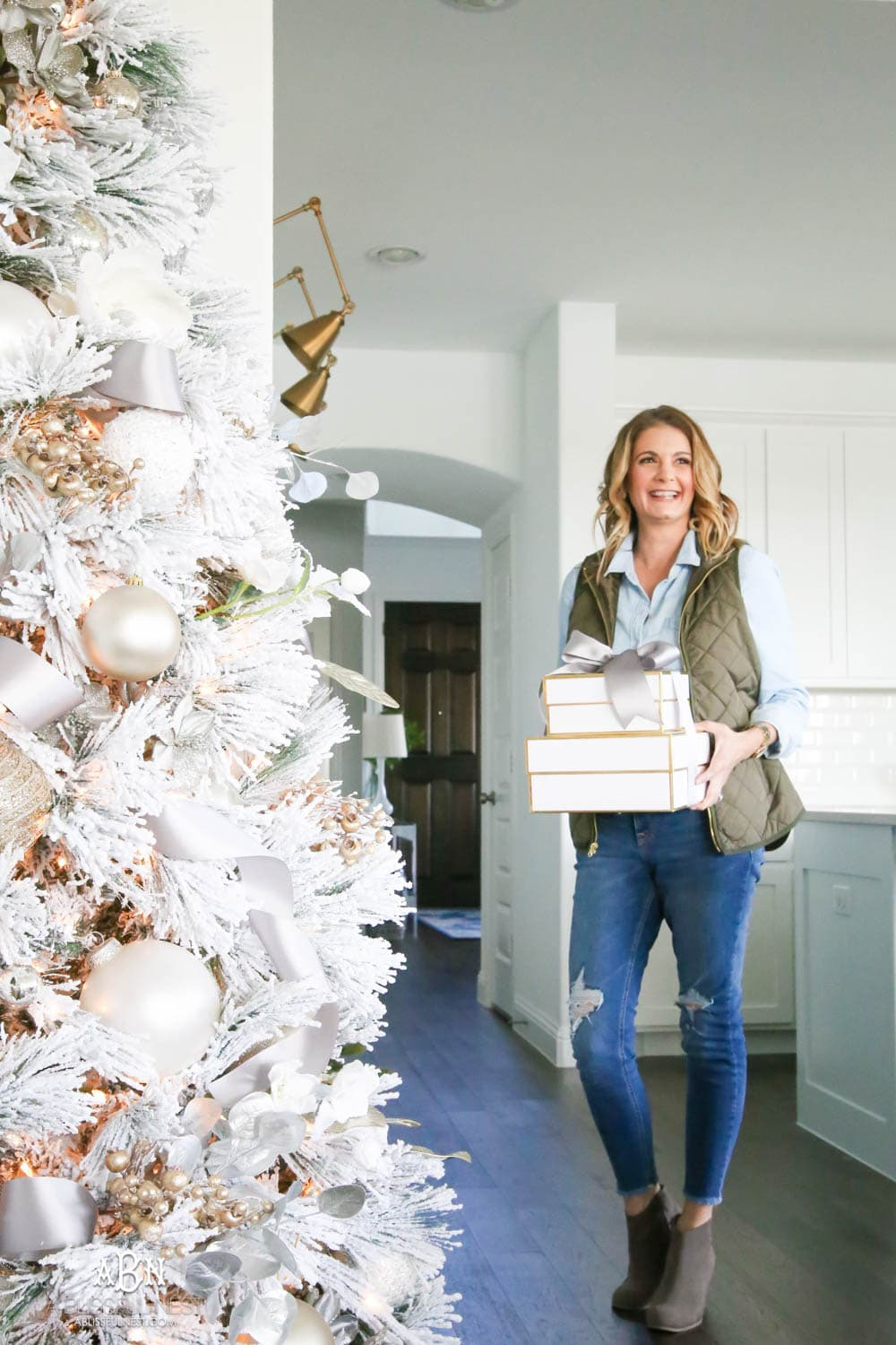 Silver and gold Christmas tree in a open concept floor plan with lots of blue home decor accents. Check out all the white, silver and gold Christmas decor in this holiday home tour on ABlissfulNest.com. #ABlissfulNest #Christmasdecor #Christmasdecorating #CoastalChristmasdecor