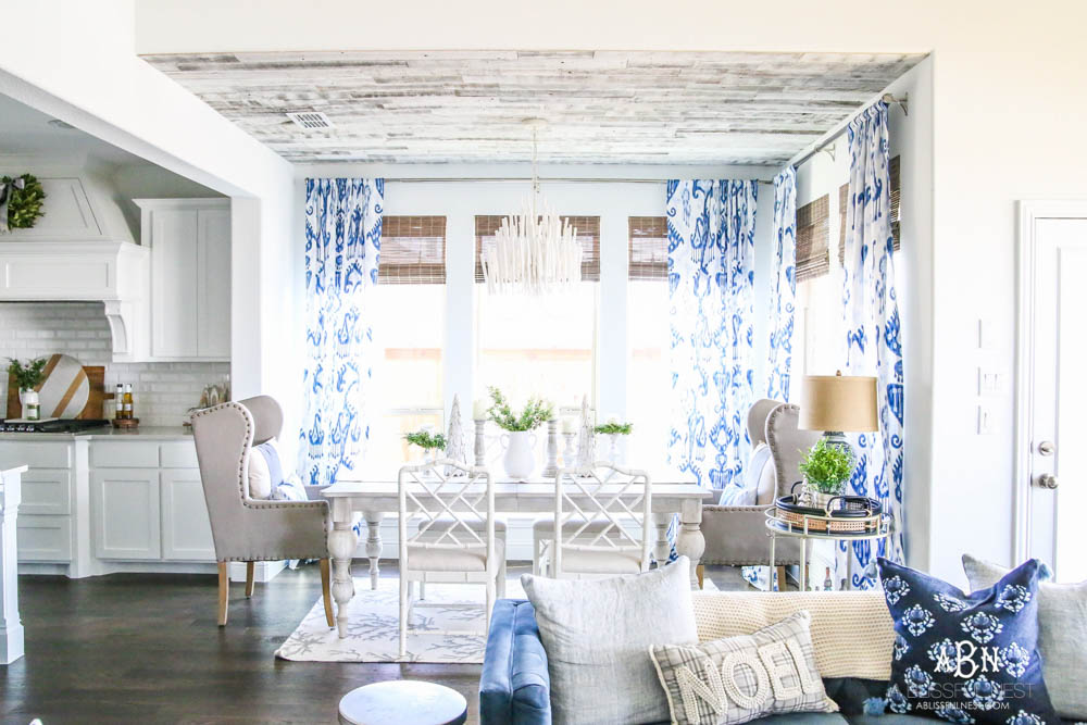 Blue and white breakfast room with coastal farmhouse style. All the sources + details in post! See more on https://ablissfulnest.com #ABlissfulNest #breakfastroom #designtips #diningroom