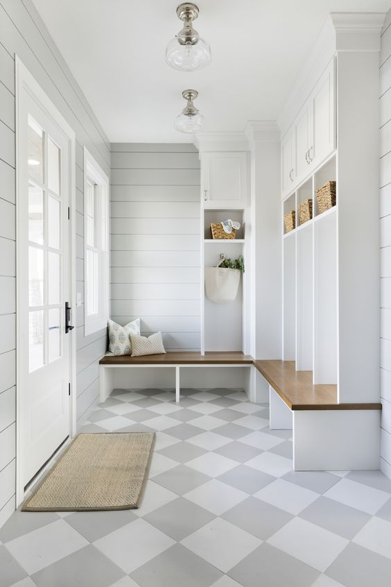 A gorgeous organized mudroom with a soft patterned floor tile.