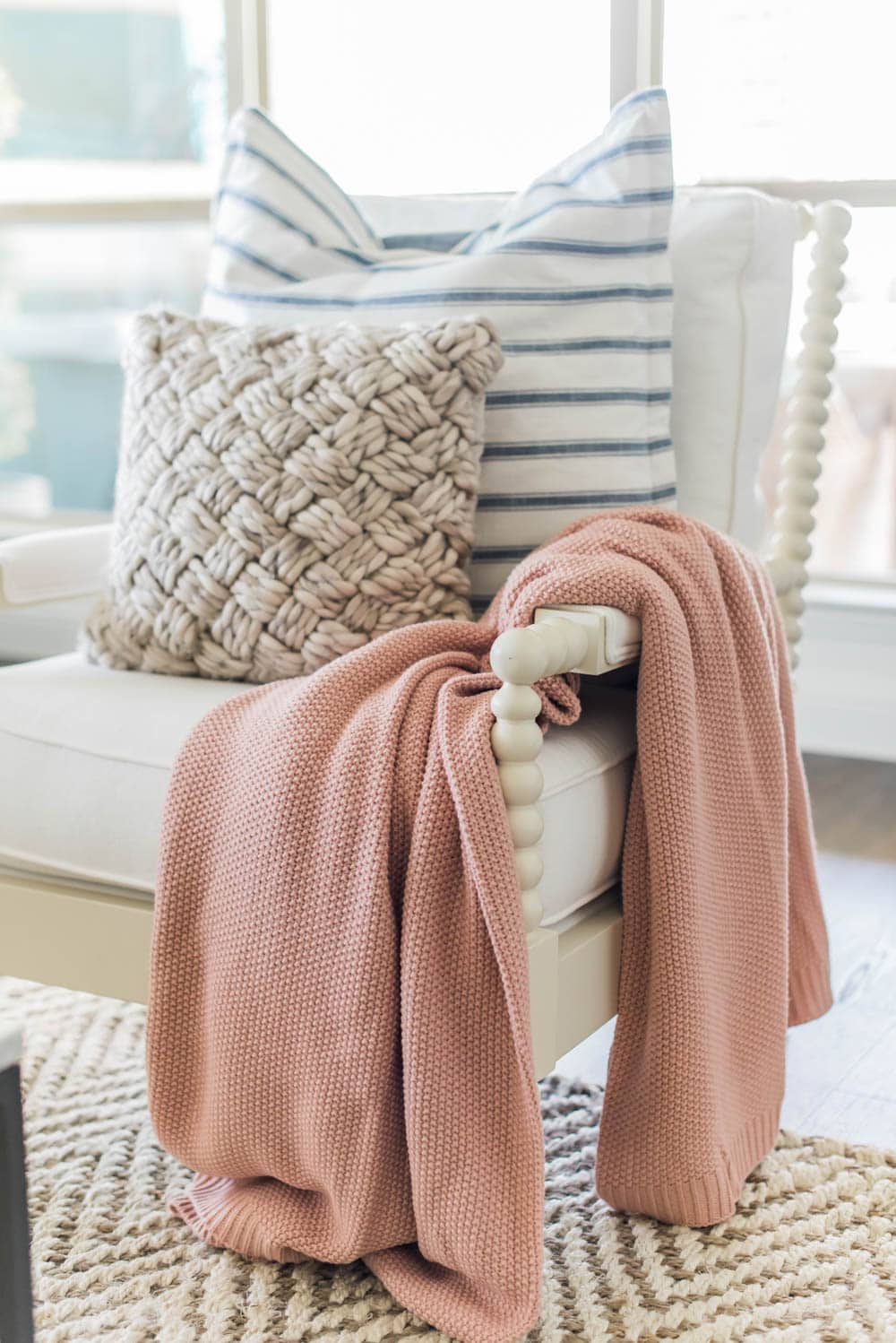 Add beautiful lightweight throw blankets to your living room for effortless spring decorating ideas. #ABlissfulNest #springideas #springdecorating