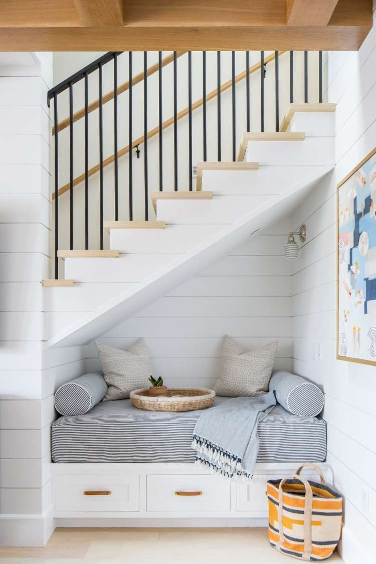 The coziest coastal nook under the stairs!