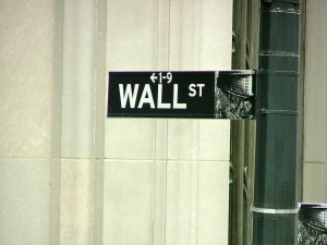 US STOCKS-Wall St slips; credit jitters offset deal news