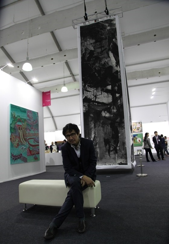 "Lan Zhenghui with his monumental installation ""Ink Monument"" at Hong Kong Art Week's Art Central"