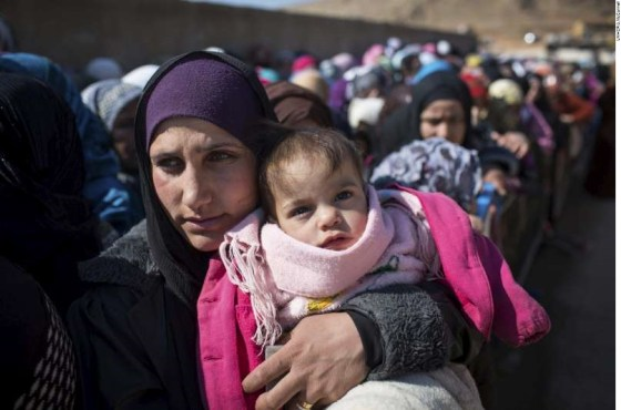 Newly arrived Syrian refugee women and children queue for registration and aid distribution in the town of Arsal, Lebanon, February 17 2014.