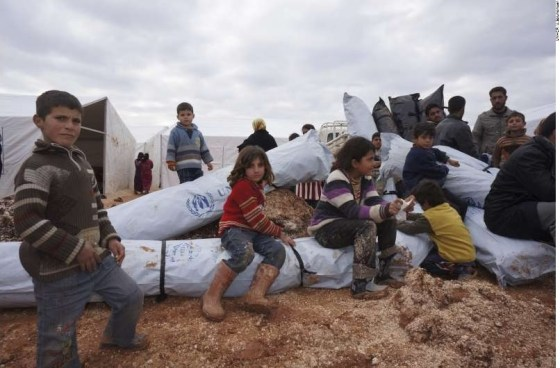 A 2013 file photo shows humanitarian aid reaching internally displaced people in the Azzas area of northern Syria.