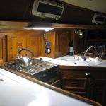 The galley with double sinks, Force 10 stove, top loading freezer and frong opening fridge