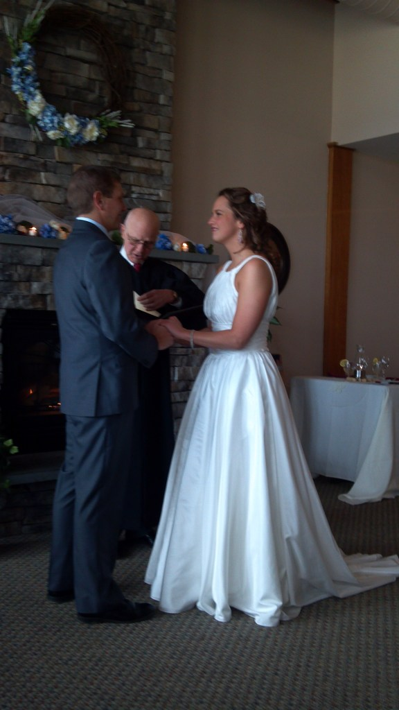 Chris and Lizze saying their vows