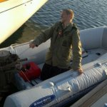 Eric overzealously starting the dinghy outboard