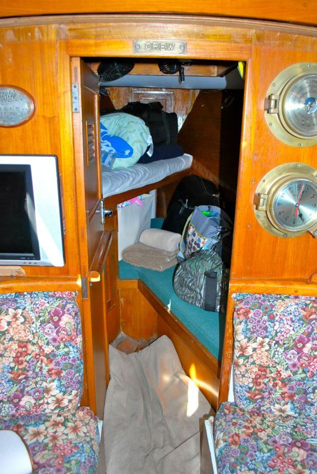 The V Berth is all the way up forward. Right now it's loaded with baby stuff. There is an upper and lower berth with a hanging locker and drawers.