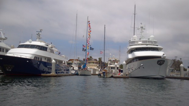 Dressed up for the 4th of July next to our megayacht neigbors in a 100 foot slip