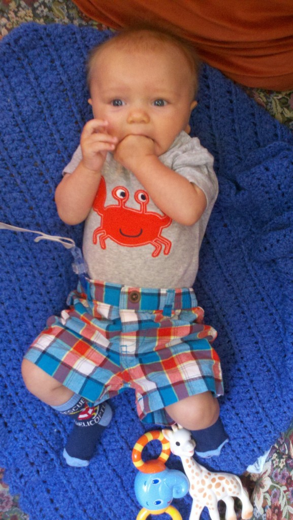 I'll leave you with a picture of Sullivan wearing his big boy pants and crabby onesie