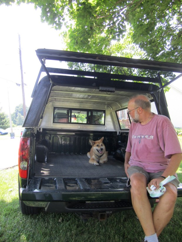Koku and Pappy hanging out under the new truck topper