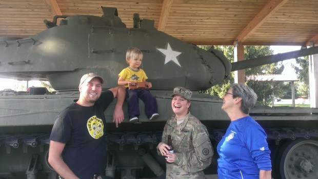 Lizze showed Sully the Army tank displays on base
