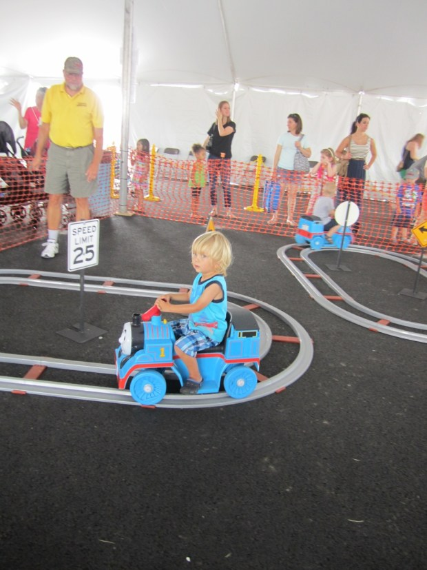 Riding a toddler sized toy Thomas