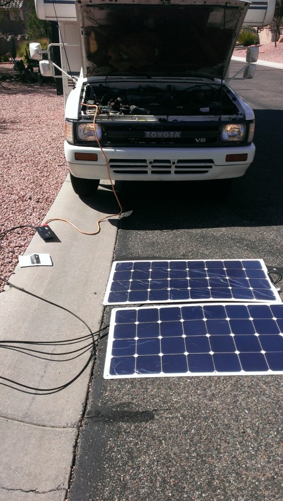 The test setup of two 100 watt solar panels and the charge controller charging the camper's battery